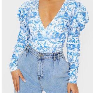 floral blue/white ruffle bodysuit